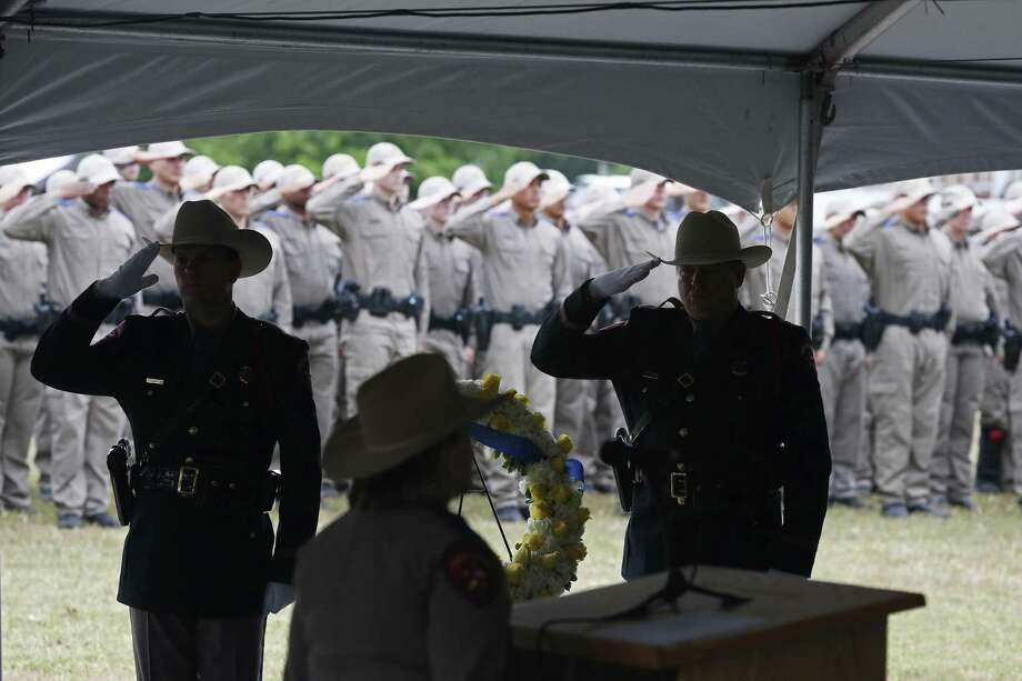 Texas Department of Public Safety troopers and cadets salute during a Memorial Service at their headquarters in Austin, Tuesday, May 16, 2017. The memorial service honored troopers who died in the line of duty. The earliest was Texas Ranger David Clark who died in 1837. Highway Patrol Trooper Bill Davidson, who was shot and killed on April 14, 1992 at the age of 43, was also honored. Family representatives placed a wreath during the event. Photo: JERRY LARA / San Antonio Express-News / © 2017 San Antonio Express-News