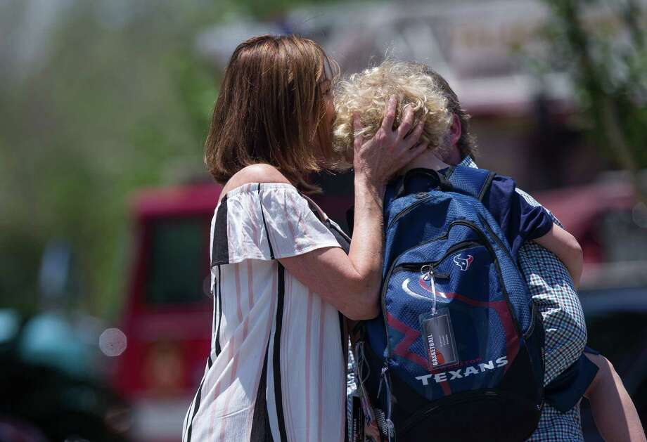 Parents picked up their children from school after a science-experiment explosion injured six children at the Yellow School at Memorial Drive Presbyterian Church on Tuesday. Wind is thought to have played a factor. Photo: Godofredo A. Vasquez, ScienceExplosion / Houston Chronicle