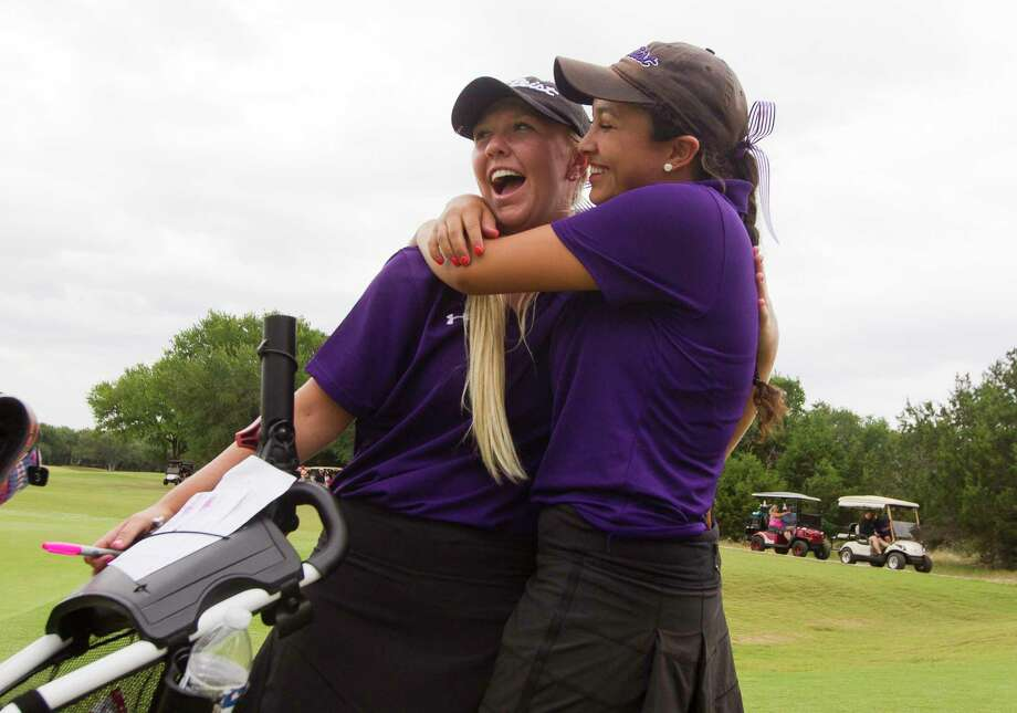 Montgomery's Hailee Cooper, left, gets a hug from IIiana Stowers after finishing the 6A girls UIL State Golf Championships at Legacy Hills Golf Club, Tuesday, May 16, 2017, in Georgetown. Cooper finished tied for eighth overall in the tournament. Photo: Jason Fochtman, Staff Photographer / © 2017 Houston Chronicle