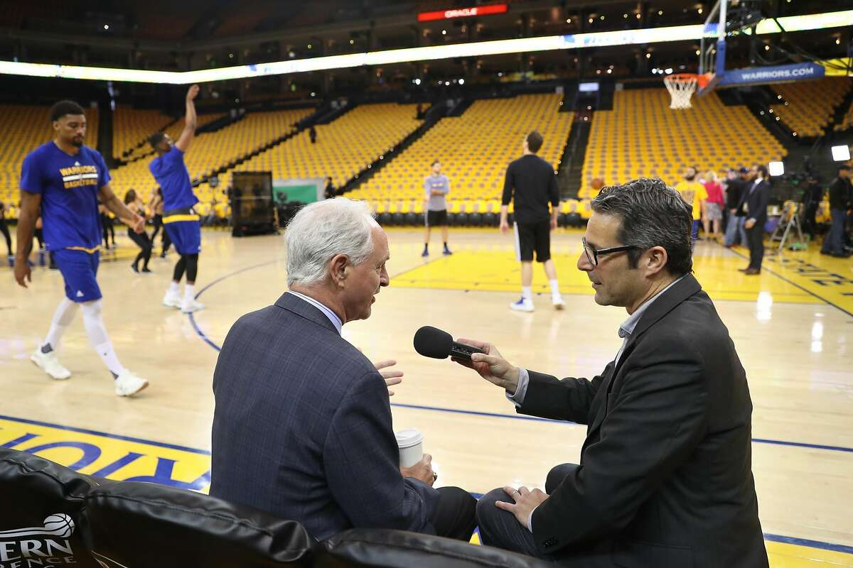 Golden State Warriors' team multimedia producer Laurence Scott interviews ABC7's Mike Schumann before Warriors play San Antonio Spurs in Game 2 of NBA Western Conference Finals in Oakland, Calif., on Tuesday, May 16, 2017.