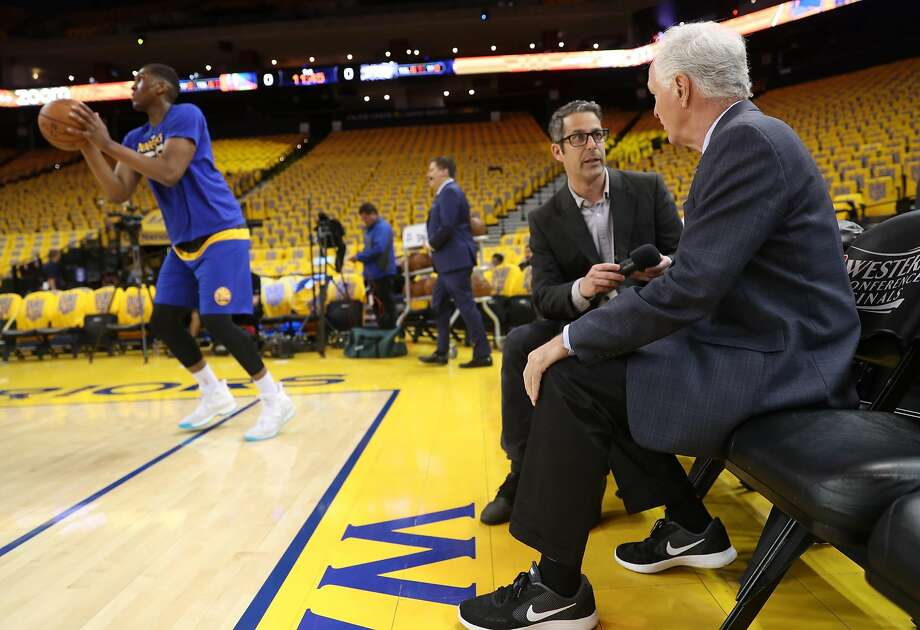 Golden State Warriors multimedia producer Laurence Scott interviews KGO's Mike Schumann for the Internet radio service. Photo: Scott Strazzante, The Chronicle