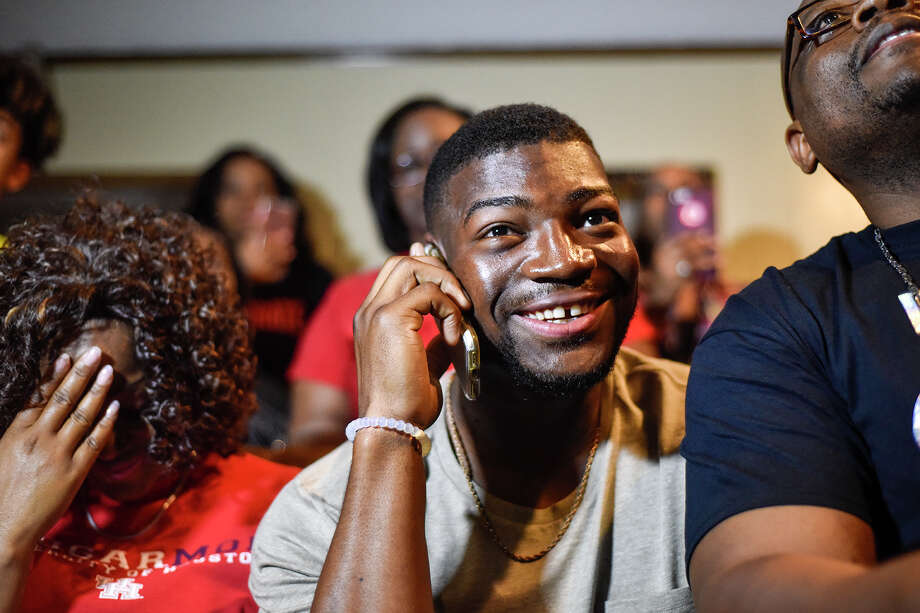 Houston linebacker Tyus Bowser talks to the Baltimore Ravens on the phone during an NFL Draft watch party at his family's home in Tyler, Texas, Friday, April 28, 2017. Bowser was drafted by the Ravens as the 47th pick in the NFL football draft. (Chelsea Purgahn/Tyler Morning Telegraph/Tyler Morning Telegraph via AP) Photo: Chelsea Purgahn, MBI / Chelsea Purgahn/Tyler Morning Telegraph