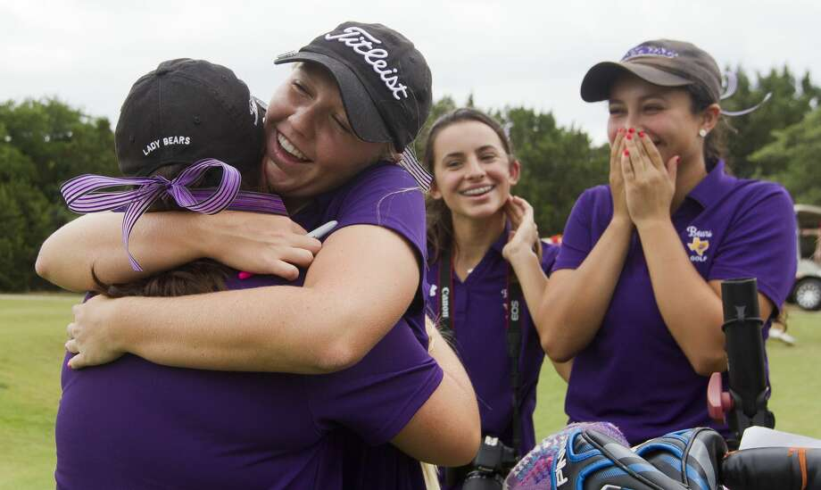Hailee Cooper, second from left, hugs Erica Bartee as IIiana Stowers reacts after competing in the 6A girls UIL State Golf Championships at Legacy Hills Golf Club, Tuesday, May 16, 2017, in Georgetown. Photo: Jason Fochtman/Houston Chronicle