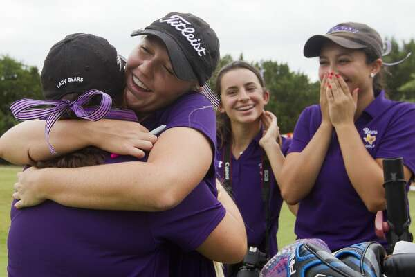 Hailee Cooper, second from left, hugs Erica Bartee as IIiana Stowers reacts after competing in the 6A girls UIL State Golf Championships at Legacy Hills Golf Club, Tuesday, May 16, 2017, in Georgetown.