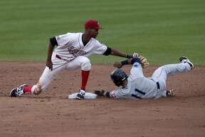 Loons' Brendon Davis tags out Lake County Captains' Jorma Rodriguez in the second inning of the Tuesday game.
