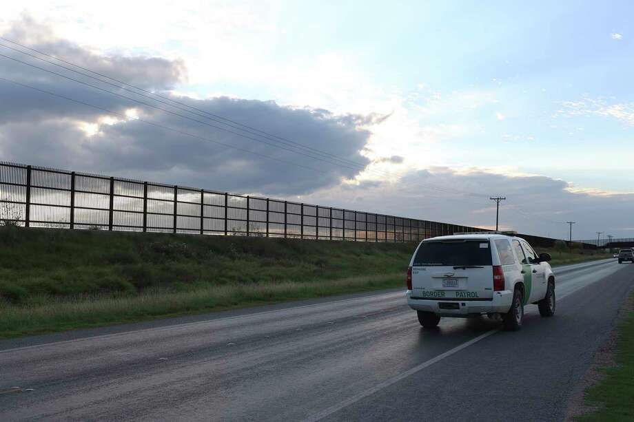 A U.S. Border Patrol unit makes its way along U.S. 281 by the U.S.-Mexico border fence near San Benito. The wall stretches in a series of broken links from Brownsville to Hidalgo County. Photo: JERRY LARA, Staff / © 2016 San Antonio Express-News