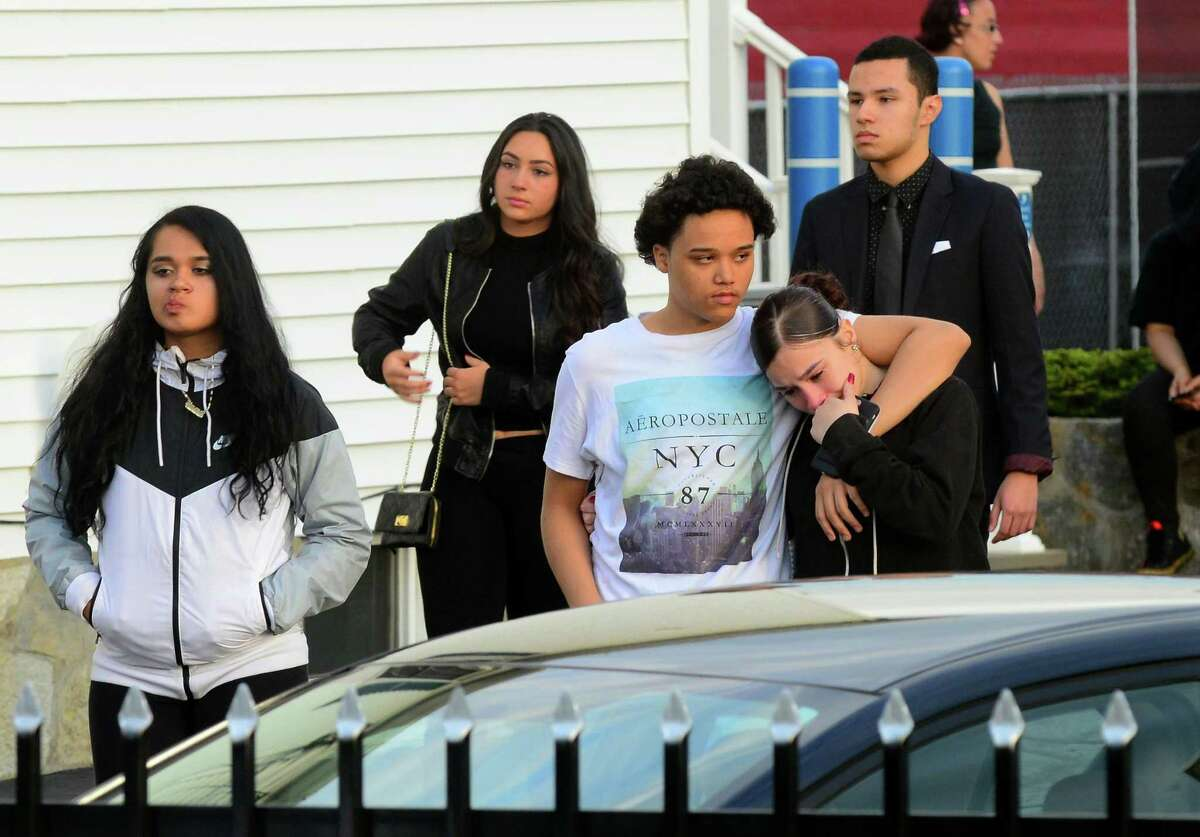 Mourners attending the wake for Jayson Negron, exit the Funeraria Luz de Paz funeral home on East Washington Street in Bridgeport, Conn., on Tuesday May 16, 2017. Negron was fatally shot by a city police officer last Tuesday night after police said he rammed the officer with a stolen car.