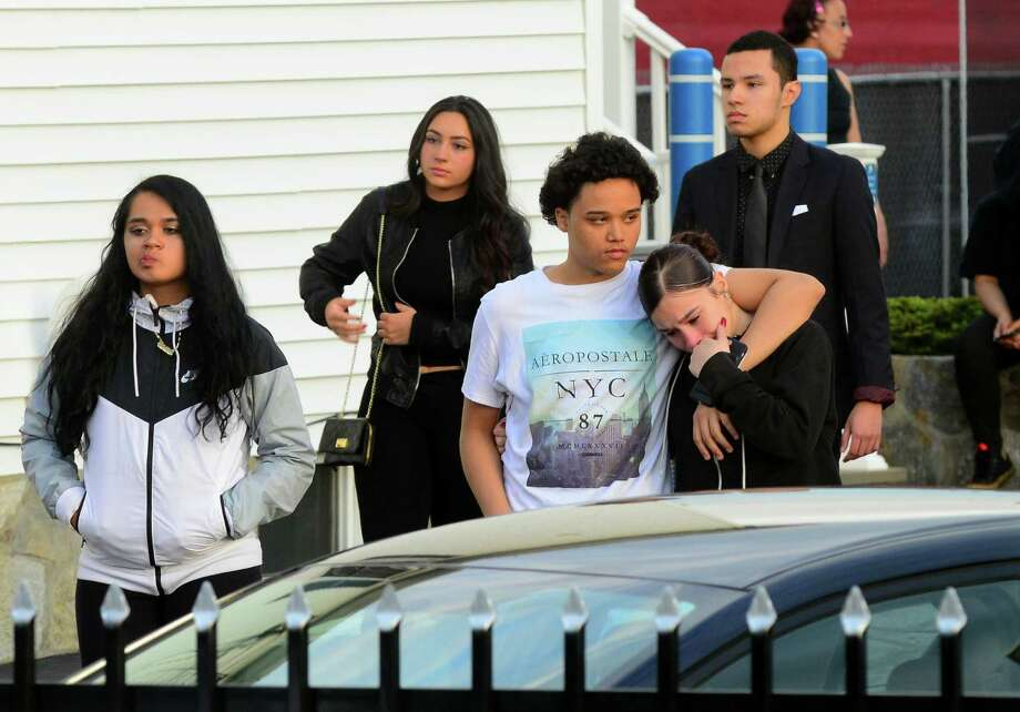 Mourners attending the wake for Jayson Negron, exit the Funeraria Luz de Paz funeral home on East Washington Street in Bridgeport, Conn., on Tuesday May 16, 2017. Negron was fatally shot by a city police officer last Tuesday night after police said he rammed the officer with a stolen car. Photo: Christian Abraham / Hearst Connecticut Media / Connecticut Post