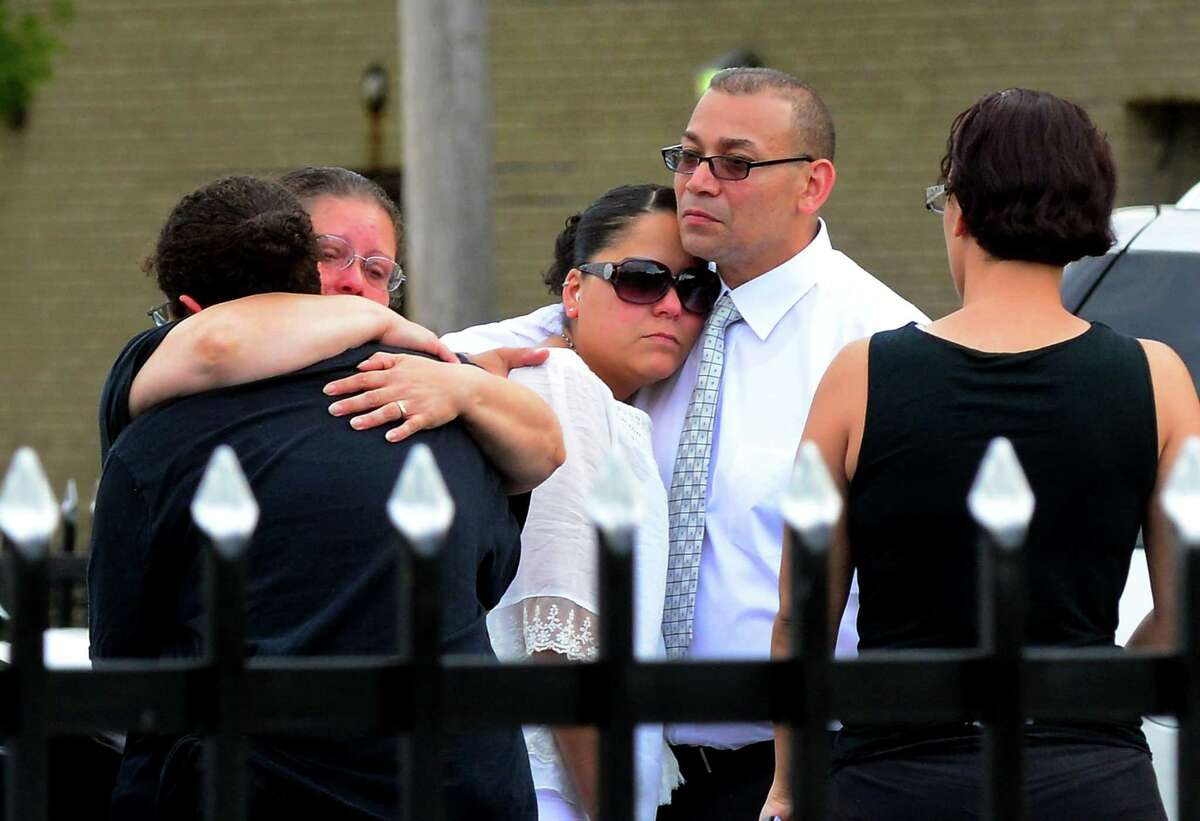 Mourners attending the wake for Jayson Negron, comfort each other outside of Funeraria Luz de Paz funeral home on East Washington Street in Bridgeport, Conn., on Tuesday May 16, 2017. Negron was fatally shot by a city police officer last Tuesday night after police said he rammed the officer with a stolen car.