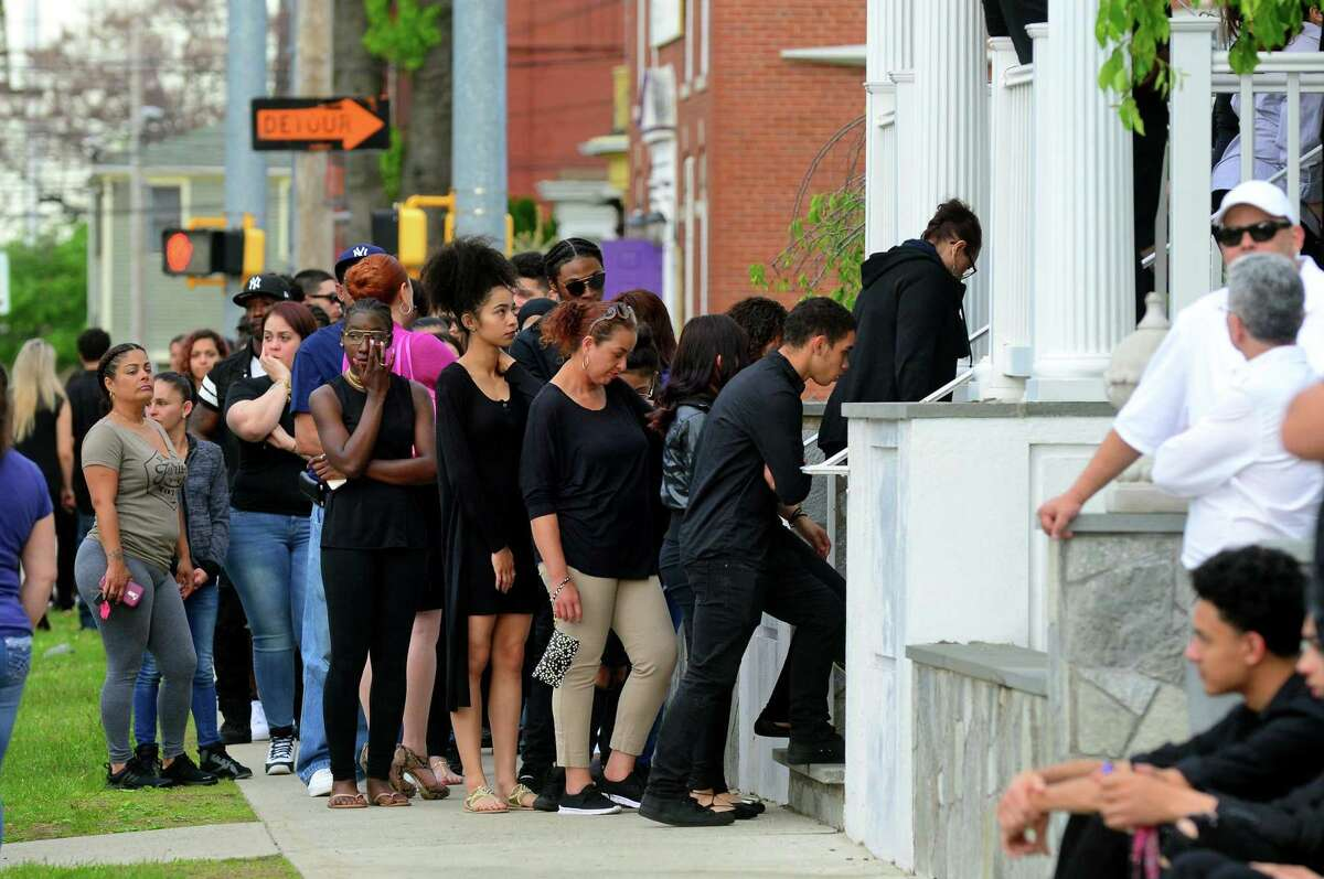 Hundreds of mourners wait in line for the wake for Jayson Negron, at Funeraria Luz de Paz funeral home on East Washington Street in Bridgeport, Conn., on Tuesday May 16, 2017. Negron was fatally shot by a city police officer last Tuesday night after police said he rammed the officer with a stolen car.