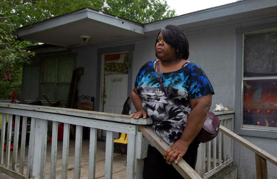 Scherhanda Hughes, 44, is considering applying for the Texas Home Investment Program in hopes of improving the house on her property on North Liberty Street in Montgomery. The grant program allows approved residents to have their homes replaced through the state. Photo: Jason Fochtman, Staff Photographer / © 2017 Houston Chronicle