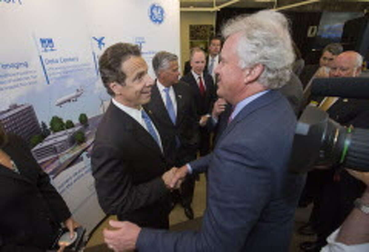 Gov. Andrew Cuomo, left, with General Electric Co. CEO Jeff Immelt during a July 2014 announcement of the $500 million Power Electronics Manufacturing Consortium that will operate a $35 million wafer fab line at SUNY Polytechnic Institute in Albany. Source: Governor's office