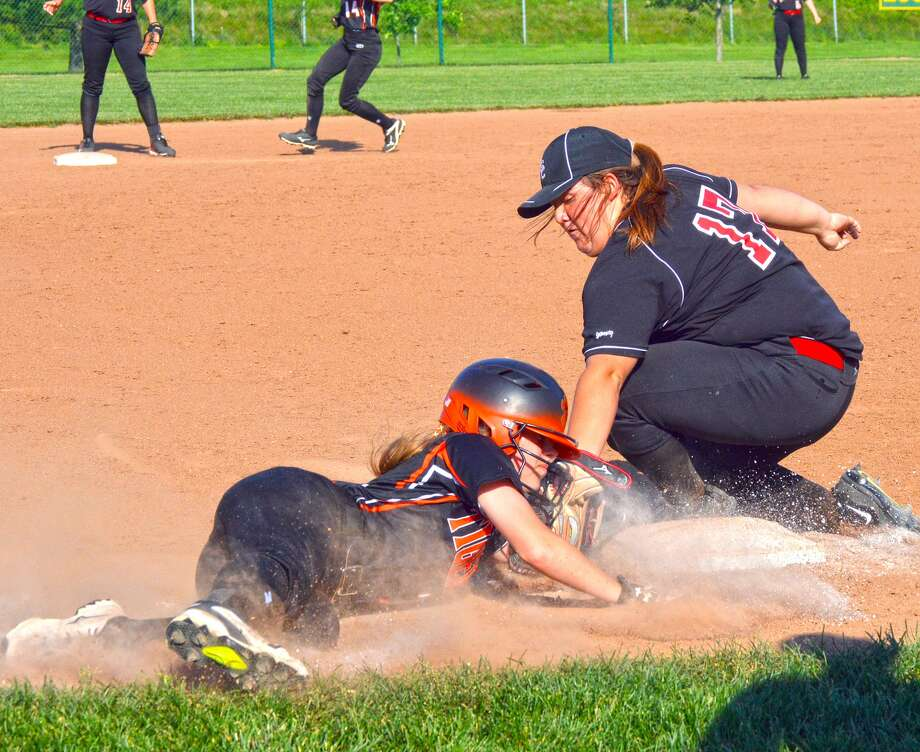 Edwardsville senior Megan Pfeiffer, left, slides in safely to third base in front of the tag from Granite City's Savannah Gibson in the fifth inning.