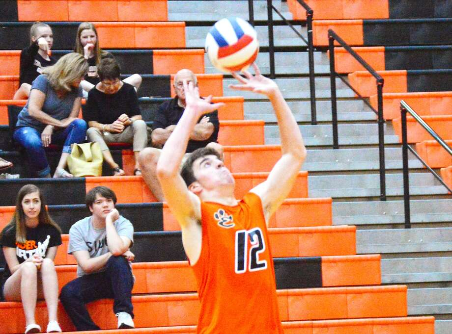 Edwardsville setter Ben Lombardi makes a pass during the first game against Belleville West on Tuesday inside Lucco-Jackson Gymnasium.