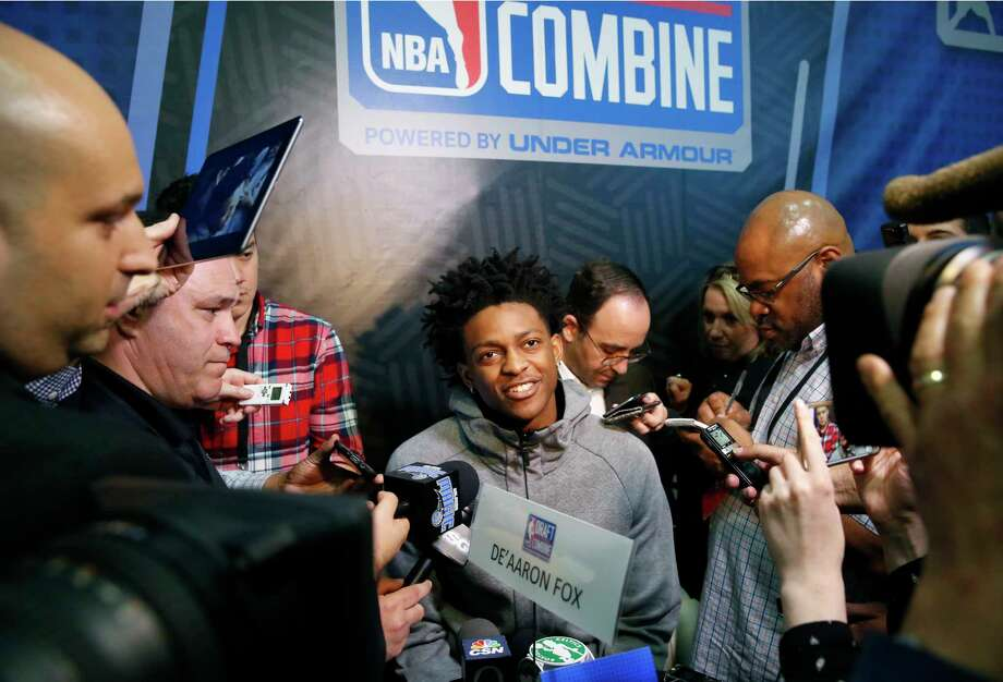 De'Aaron Fox, center, from Kentucky, listens to a question at the NBA draft basketball combine Friday, May 12, 2017, in Chicago. (AP Photo/Charles Rex Arbogast) Photo: Charles Rex Arbogast, STF / Copyright 2017 The Associated Press. All rights reserved.