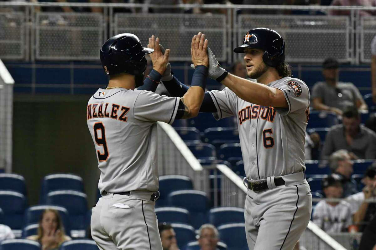 MIAMI, FL - MAY 16: Marwin Gonzalez #9 of the Houston Astros congratulates Jake Marisnick #6 after he hit a home run in the third inning against the Miami Marlins at Marlins Park on May 16, 2017 in Miami, Florida.