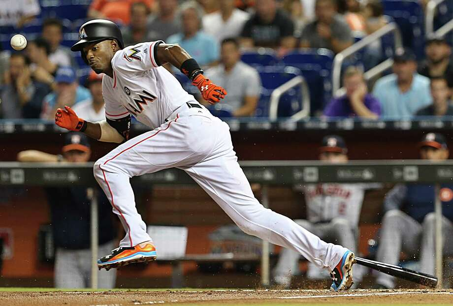 The Miami Marlins' Dee Gordon runs to first base on an infield single, and to third base on a throwing error by Houston Astros pitcher Dallas Keuchel, in the first inning at Marlins Park in Miami on Tuesday, May 16, 2017. Photo: Pedro Portal, TNS / El Nuevo Herald
