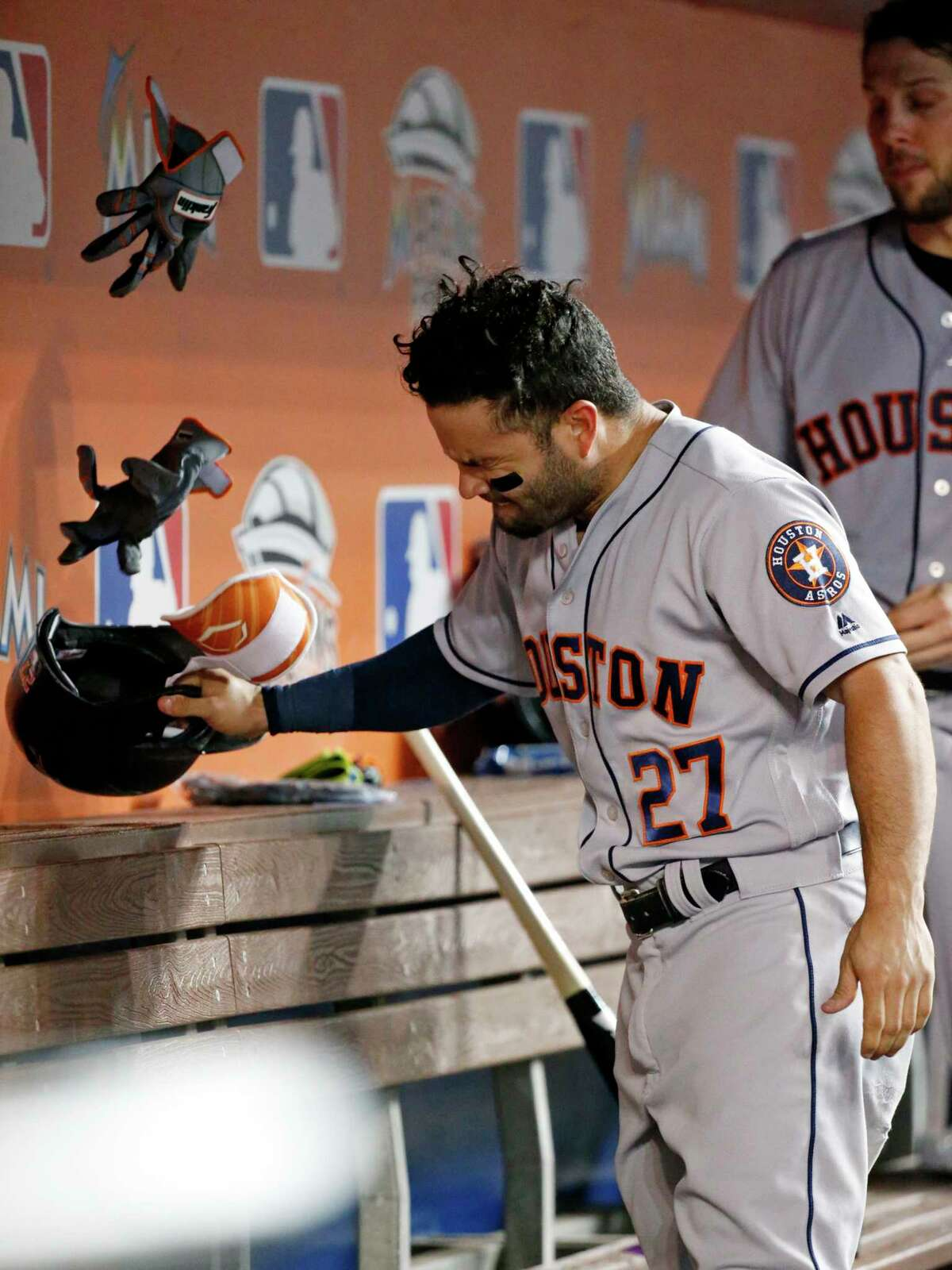 Houston Astros' Jose Altuve reacts after he grounded out during the fourth inning of the team's baseball game against the Miami Marlins, Tuesday, May 16, 2017, in Miami. (AP Photo/Wilfredo Lee)