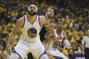 Golden State Warriors' JaVale McGee and Patrick McCaw fight San Antonio Spurs' David Lee for position in the first quarter during Game 2 of the 2017 NBA Playoffs Western Conference Finals at Oracle Arena on Tuesday, May 16, 2017 in Oakland, Calif.