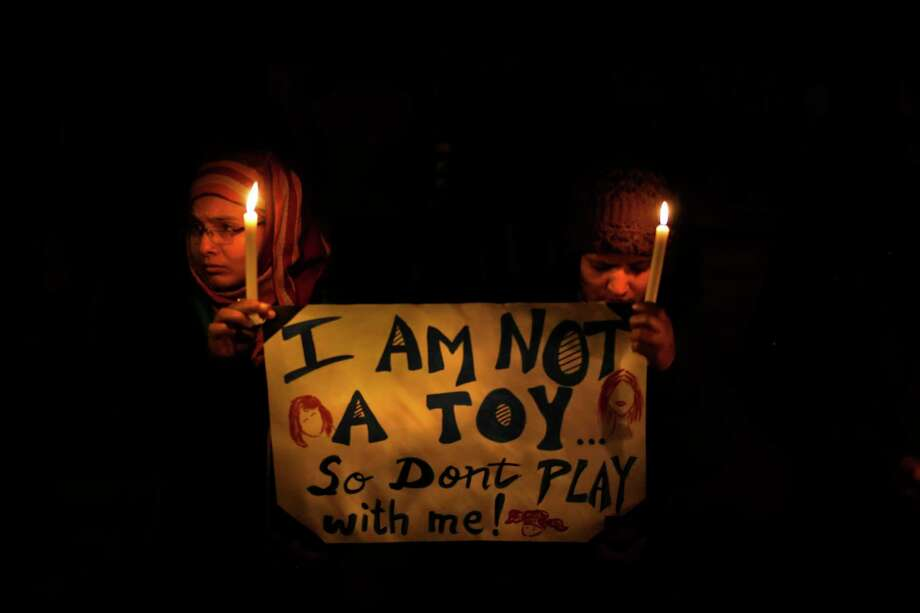 Indians held a candle light vigil to mourn the death of a gang rape victim and urge the government to make several key reforms to ensure safety of women. Photo: Saurabh Das, STF / Copyright 2017 The Associated Press. All rights reserved.