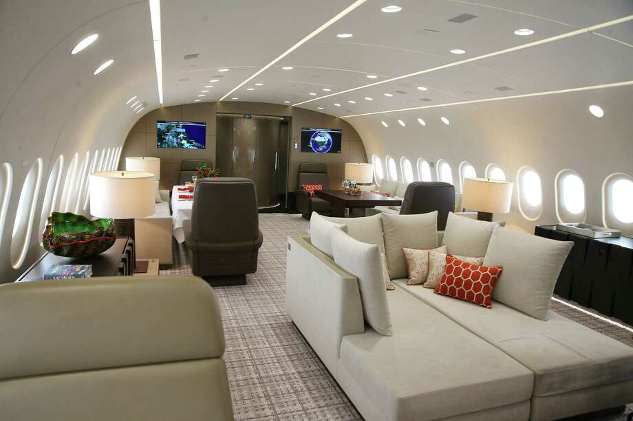"An open lounge area is featured aboard a 2,400-square-foot luxury Boeing 787-8 charter plane, displayed for the first time in the United States, Tuesday, May 16, 2017, at the Museum of Flight in Seattle. It is the world's largest ""bizliner"" available for charter. Photo: GENNA MARTIN, SEATTLEPI.COM / SEATTLEPI.COM"