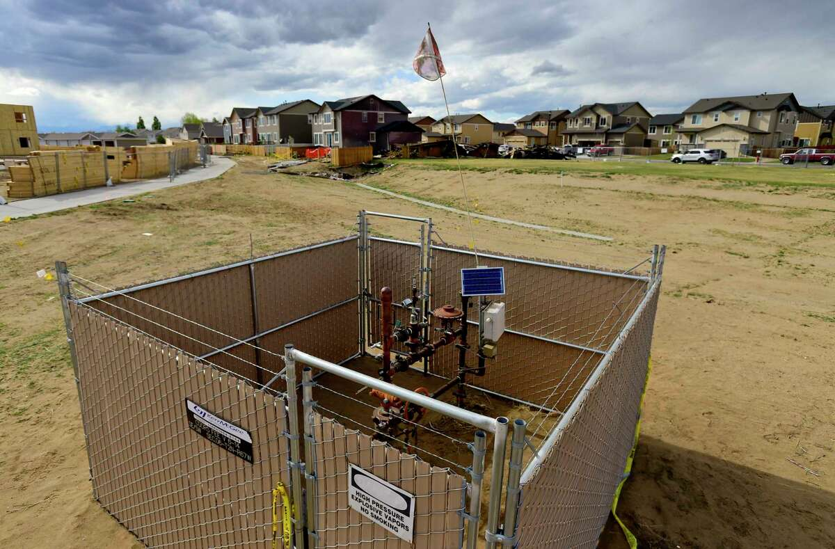 A well head is situated in an enclosure near a house that was destroyed on April 17 in a fatal explosion in Firestone, Colo. The pipeline cited in the explosion was one of two that often connect wells to storage tanks.