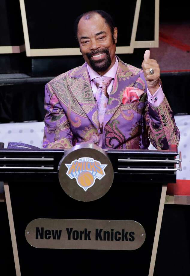 "New York Knicks legend Walt ""Clyde"" Frazier shows off his sartorial splendor while representing the Knicks for the NBA basketball draft lottery in 2017. Photo: Frank Franklin II / Copyright 2017 The Associated Press. All rights reserved."