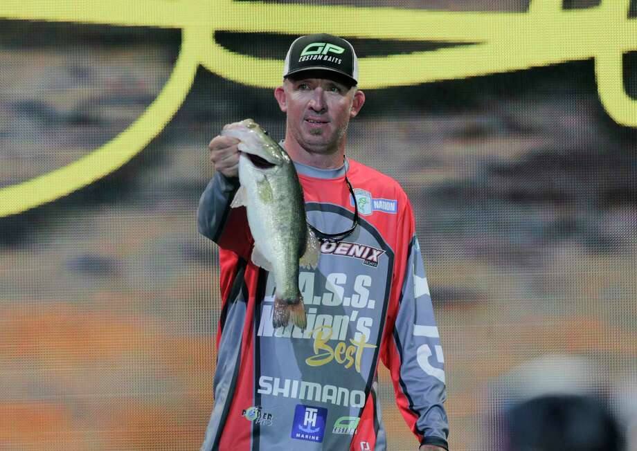 Darrell Ocamica holds up a bass after weigh in for the  Bassmaster Classic on Saturday, March 25, 2017, in Houston. Ocamica came in 38th place. ( Elizabeth Conley / Houston Chronicle ) Photo: Elizabeth Conley, Staff / Stratford Booster Club