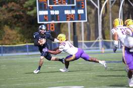 Maine quarterback Dan Collins, who threw for three touchdowns, tries to escape the rush of UAlbany's Abner Logan in their game at Alfond Stadium in Orono, Maine, on Saturday, Oct. 15, 2016. (Mo Karim / UMaine Athletics)