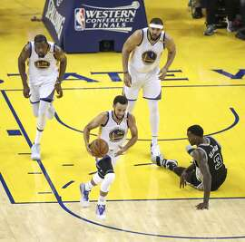 Golden State Warriors' Stephen Curry runs down court in the third quarter during Game 2 of the 2017 NBA Playoffs Western Conference Finals at Oracle Arena on Tuesday, May 16, 2017 in Oakland, Calif.