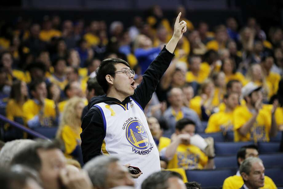 Danny Hu, who travelled from Shanghai, China to watch the basketball game, cheers during the third quarter of Game 2 of the NBA Western Conference Finals between the Golden State Warriors and San Antonio Spurs on Tuesday, May 16, 2017, at Oracle Arena in Oakland, Calif. Photo: Santiago Mejia, The Chronicle