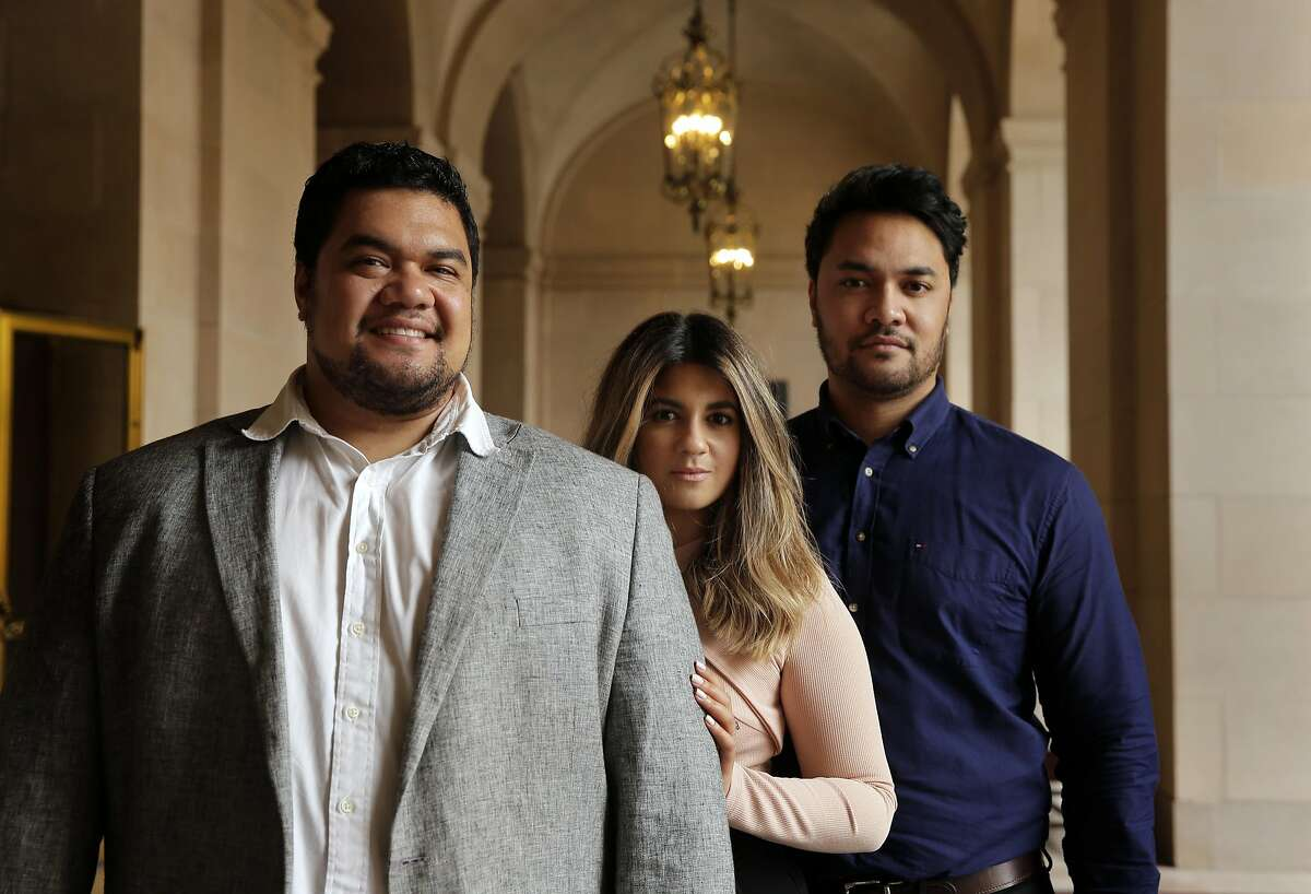 Tenor Pene Pati, (left)i s about to star in SF Opera's production of Rigoletto, along with his wife Amina Edris and his brother Amitai Pati. They pose for a portrait at the War Memorial Opera House San Francisco, Ca., on Tuesday May 16, 2017.
