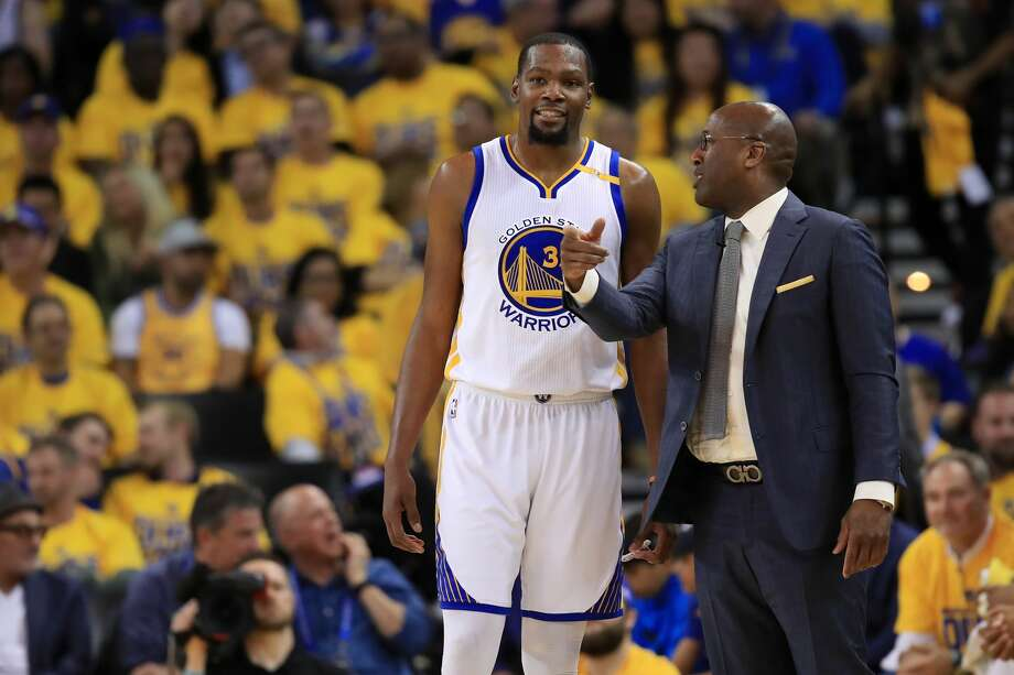 OAKLAND, CA - MAY 16:  Kevin Durant #35 of the Golden State Warriors speaks with acting head coach Mike Brown during Game Two of the NBA Western Conference Finals against the San Antonio Spurs at ORACLE Arena on May 16, 2017 in Oakland, California. NOTE TO USER: User expressly acknowledges and agrees that, by downloading and or using this photograph, User is consenting to the terms and conditions of the Getty Images License Agreement.  (Photo by Ezra Shaw/Getty Images) Photo: Ezra Shaw/Getty Images
