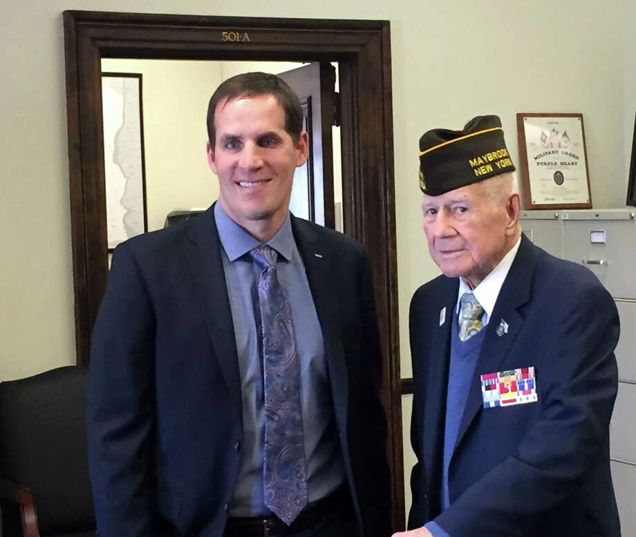 Scott Smiley, left, with State Sen. William Larkin Jr., right, at Larkin's office in the Legislative Office Building on Tuesday, May 16, 2017, Albany, N.Y. Smiley, a 2003 West Point graduate and an Army captain, lost his sight in 2005 while serving in Iraq. (State Senate photo)