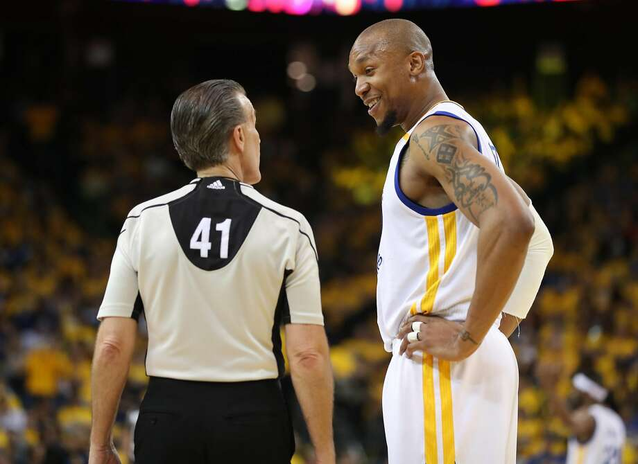 Golden State Warriors' David West talks with referee Ken Mauer in 4th quarter of Warriors' 136-100 win over San Antonio Spurs in Game 2 of NBA Western Conference Finals in Oakland, Calif., on Tuesday, May 16, 2017. Photo: Scott Strazzante, The Chronicle