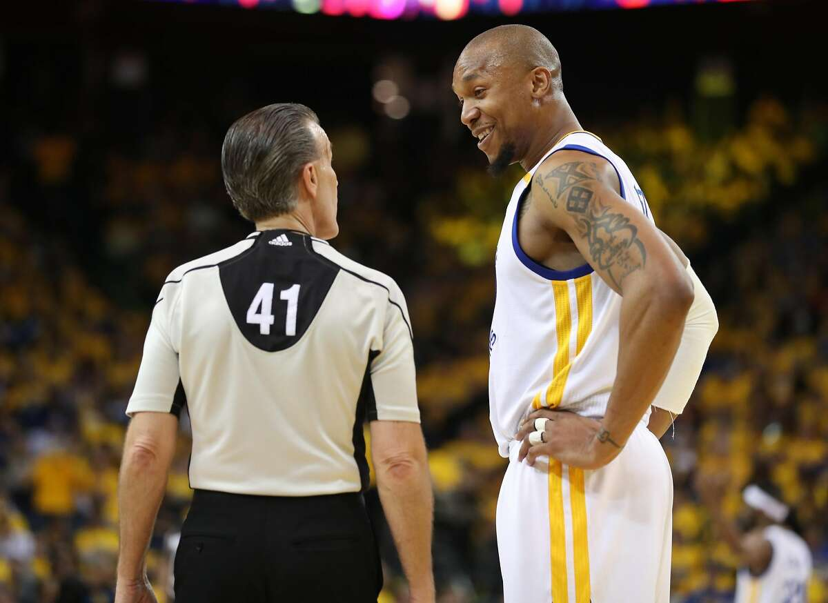 Golden State Warriors' David West talks with referee Ken Mauer in 4th quarter of Warriors' 136-100 win over San Antonio Spurs in Game 2 of NBA Western Conference Finals in Oakland, Calif., on Tuesday, May 16, 2017.