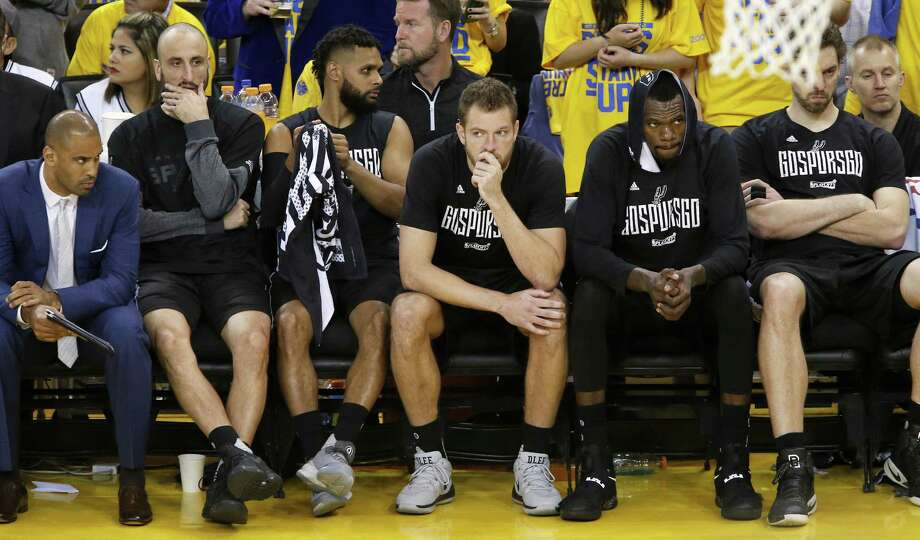 San Antonio Spurs assistant coach Ime Udoka (from left) Manu Ginobili, Patty Mills, David Lee, Dewayne Dedmon, and Pau Gasol sit dejected on the bench during second half action in Game 2 of the Western Conference Finals against the Golden State Warriors held Tuesday May 16, 2017 at Oracle Arena in Oakland, CA. Photo: Edward A. Ornelas, Staff / San Antonio Express-News / © 2017 San Antonio Express-News