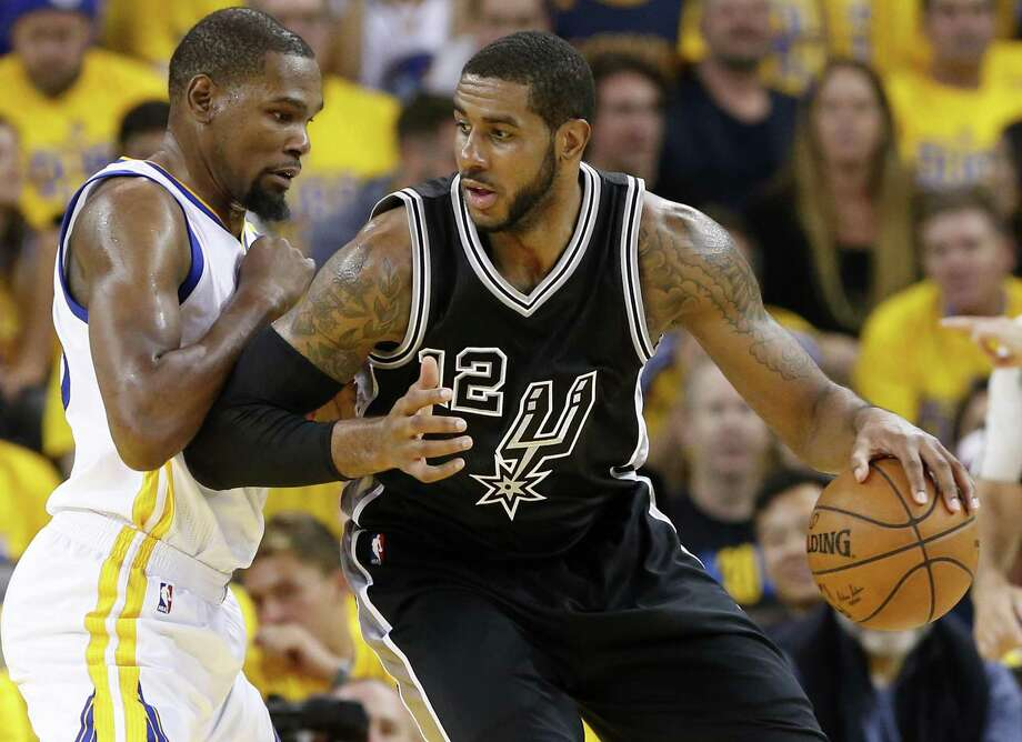 Golden State Warriors' Kevin Durant defends the Spurs' LaMarcus Aldridge during second half action in Game 2 of the Western Conference finals on May 16, 2017 at Oracle Arena in Oakland, Calif. Photo: Edward A. Ornelas /San Antonio Express-News / © 2017 San Antonio Express-News
