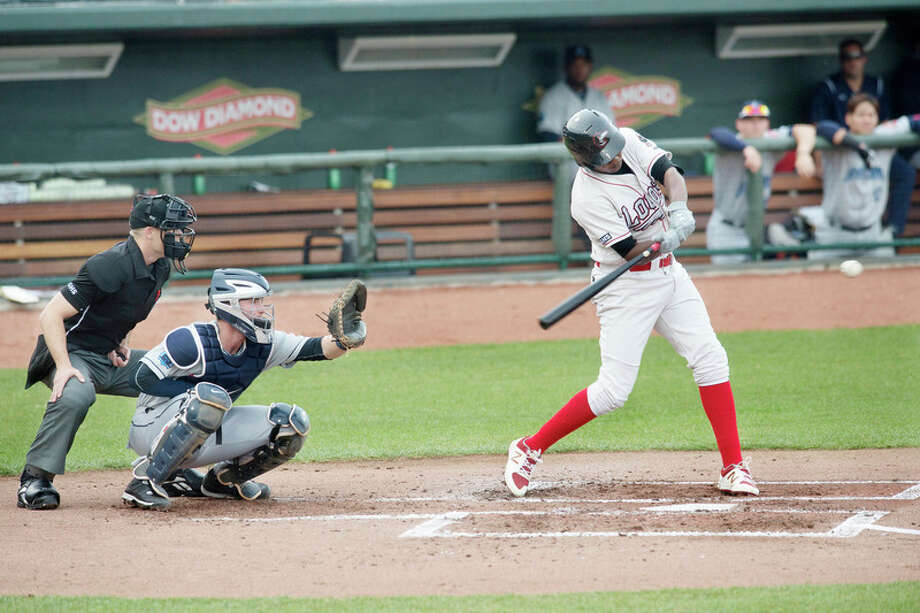 BRITTNEY LOHMILLER | blohmiller@mdn.net The Loons' Carlos Rincon swings at a pitch against Lake County on Tuesday at Dow Diamond. / Midland Daily News