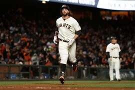 SAN FRANCISCO, CA - MAY 16: Brandon Belt #9 of the San Francisco Giants runs to home plate after hitting a solo home run in the fourth inning against the Los Angeles Dodgers at AT&T Park on May 16, 2017 in San Francisco, California. (Photo by Lachlan Cunningham/Getty Images)