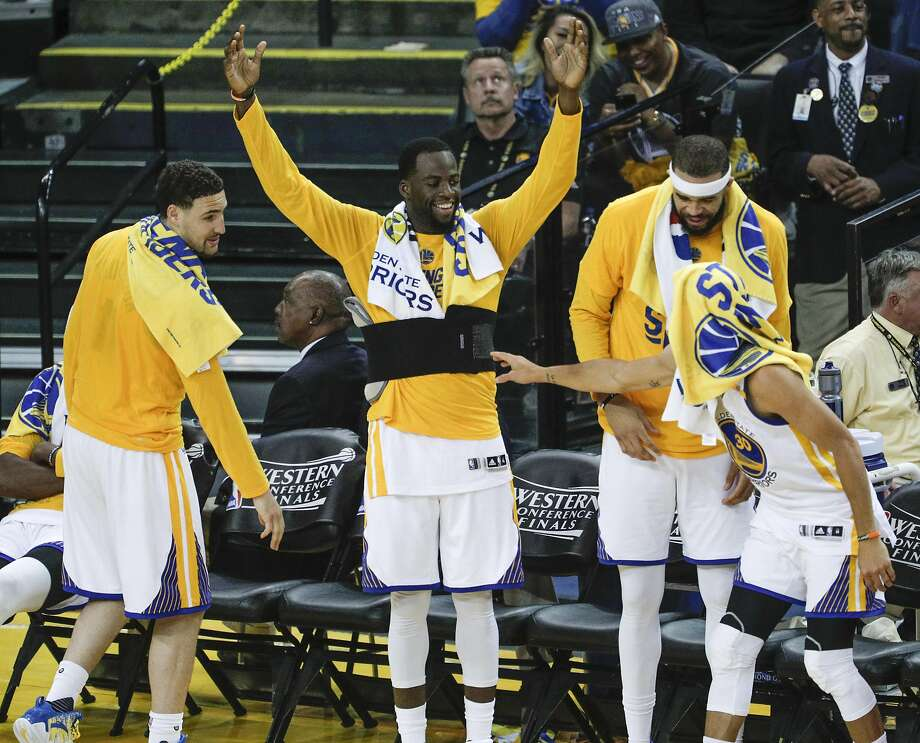 Golden State Warriors' Klay Thompson, Draymond Green, JaVale McGee and Stephen Curry are seen in the fourth quarter during Game 2 of the 2017 NBA Playoffs Western Conference Finals at Oracle Arena on Tuesday, May 16, 2017 in Oakland, Calif. Photo: Carlos Avila Gonzalez, The Chronicle