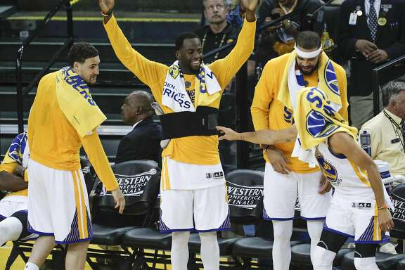 Golden State Warriors' Klay Thompson, Draymond Green, JaVale McGee and Stephen Curry are seen in the fourth quarter during Game 2 of the 2017 NBA Playoffs Western Conference Finals at Oracle Arena on Tuesday, May 16, 2017 in Oakland, Calif.