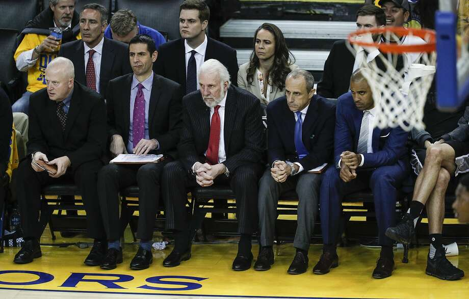 San Antonio Spurs' Head Coach Gregg Popovich and his coaching staff watch the fourth quarter during Game 2 of the 2017 NBA Playoffs Western Conference Finals at Oracle Arena on Tuesday, May 16, 2017 in Oakland, Calif. Photo: Carlos Avila Gonzalez, The Chronicle