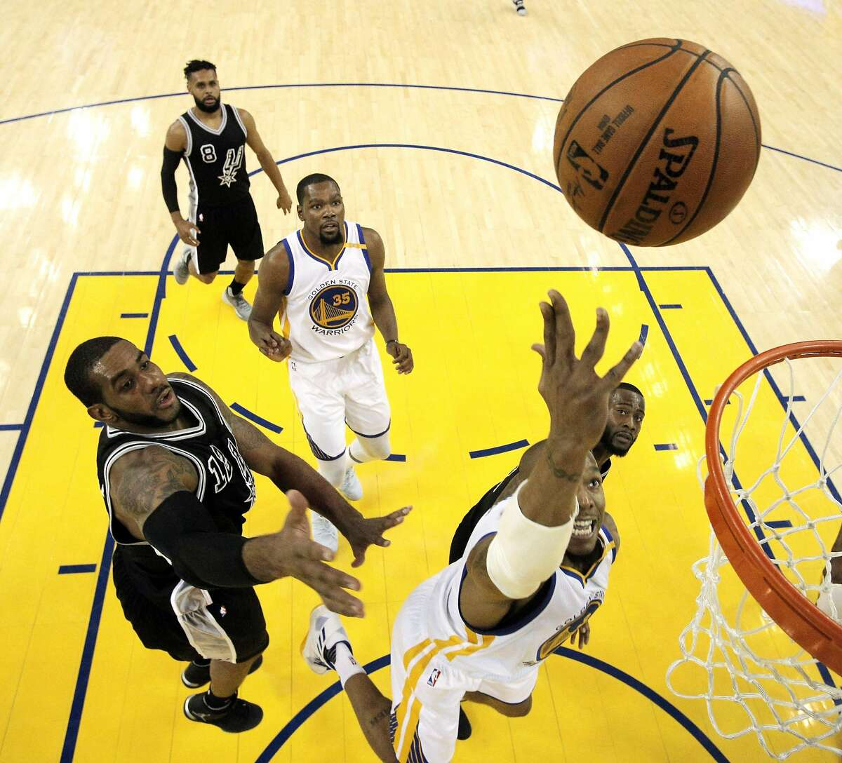David West (3) puts in a layup in the first half as the Golden State Warriors played the San Antonio Spurs at Oracle Arena in Oakland, Calif., on Tuesday, May 16, 2017, in game 2 of the Western Conference Finals.