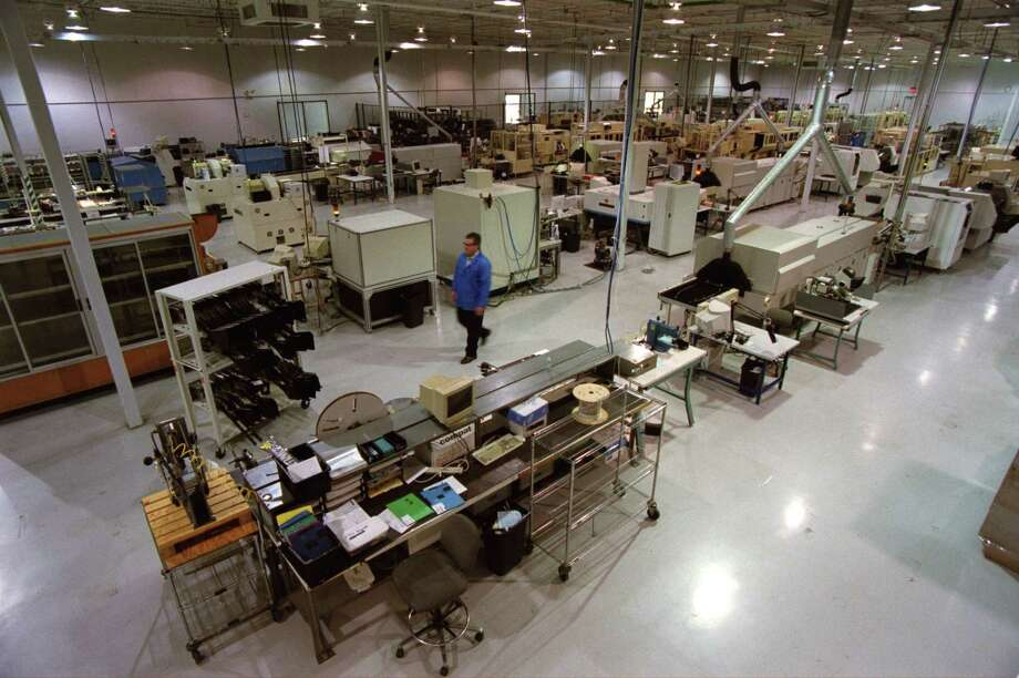 The Benchmark Electronics manufacturing facility in Angleton won't be affected by the company moving its corporate headquarters to the greater Phoenix area. This file photo is from 2003 and shows a factory floor filled with circuit boards.  Photo: John Everett, Houston Chronicle / Houston Chronicle