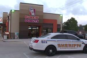 Two robbers are at large after holding up employees of at a northwest Harris County Dunkin' Donuts at gunpoint. (Metro Video)