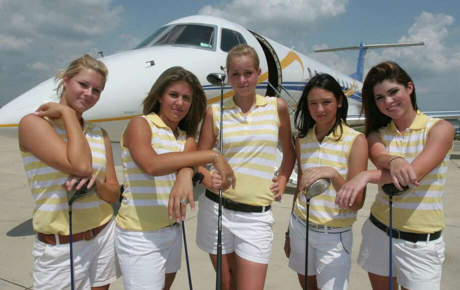 "Mary Summers, left to right, Abby Oberthier, Kristin Foyteck, Lisa McCloskey and Emily Bartholet, members of Montgomery's golf team at the Lone Star Executive Airport in Conroe. The golf team was at the airport for a team photo that they called, ""soaring for six."" The team has won five championships in a row and is going for their sixth. May 2, 2006.   (For the Chronicle/Gary Fountain) Photo: Gary Fountain, Freelance / Freelance"