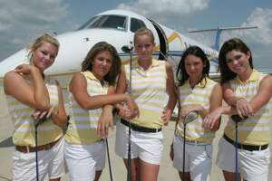 "Mary Summers, left to right, Abby Oberthier, Kristin Foyteck, Lisa McCloskey and Emily Bartholet, members of Montgomery's golf team at the Lone Star Executive Airport in Conroe. The golf team was at the airport for a team photo that they called, ""soaring for six."" The team has won five championships in a row and is going for their sixth. May 2, 2006.   (For the Chronicle/Gary Fountain)"