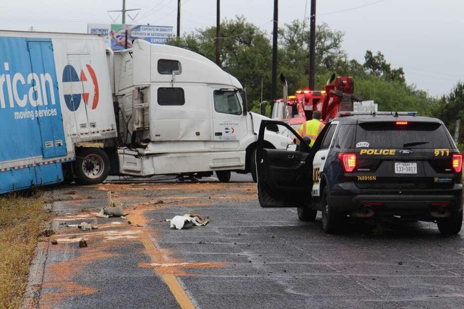Truck Flips 18 Wheelers Jackknife As Wet Roads Affect