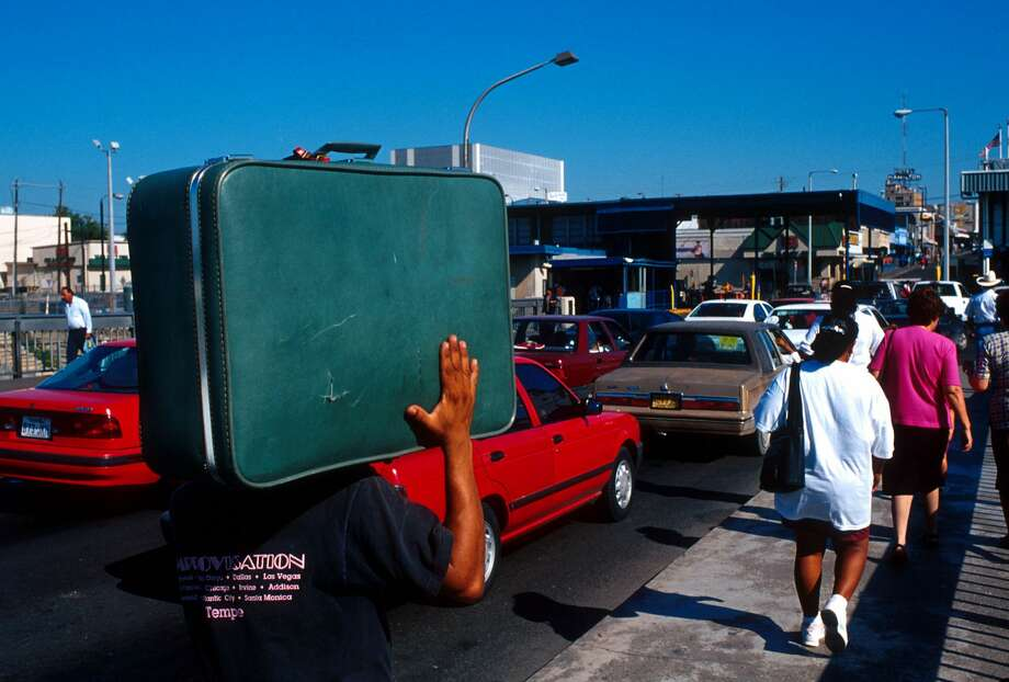 A Mexican man carries his suitcase on his shoulders September 15, 1991 at a border crossing in Nuevo Laredo, Mexico into Laredo, Texas. Keep clicking through this gallery to see photos of Nuevo Laredo from the last few decades. Photo: Per-Anders Pettersson/Getty Images